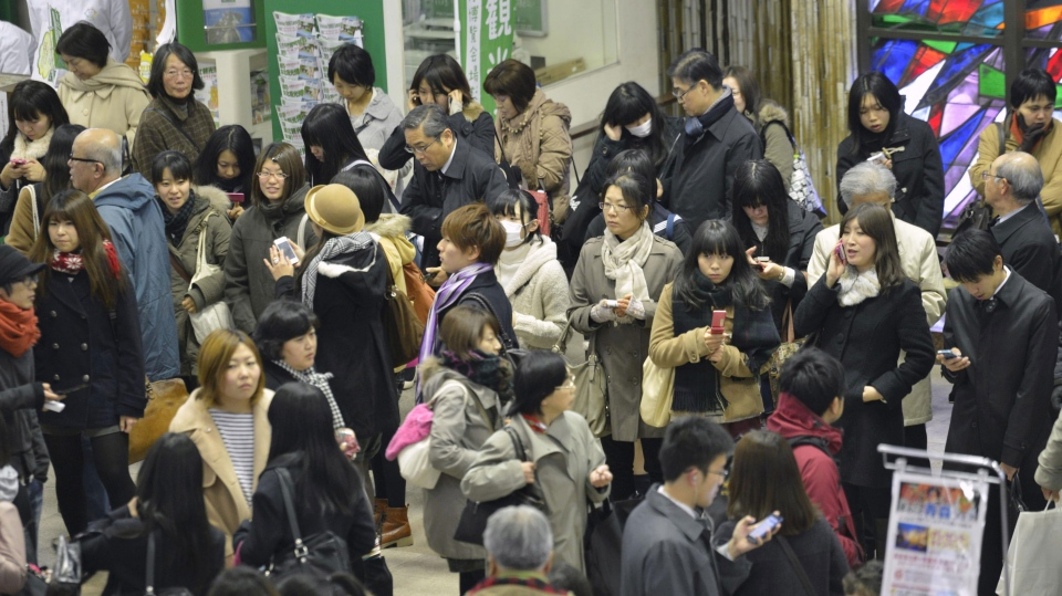 People stranded at Sendai railway station in Sendai, Miyagi Prefecture after trains were halted following a strong earthquake that struck off the coast of northeastern Japan Friday, Dec. 7, 2012. (Kyodo News)