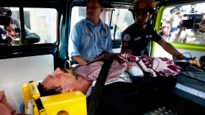 Software company founder John McAfee lies inside an ambulance, to be transferred from an immigration detention center to a hospital, in Guatemala City, Thursday, Dec. 6, 2012. (AP / Moises Castillo)