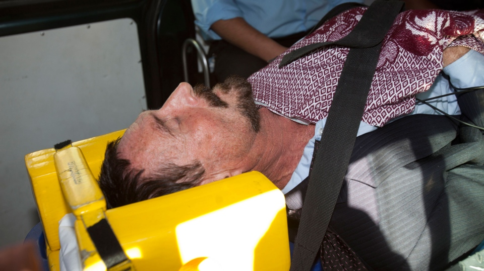 Software company founder John McAfee lies on a gurney inside an ambulance, to be transferred from an immigration detention center to a hospital, in Guatemala City, Thursday, Dec. 6, 2012. (AP / Moises Castillo)