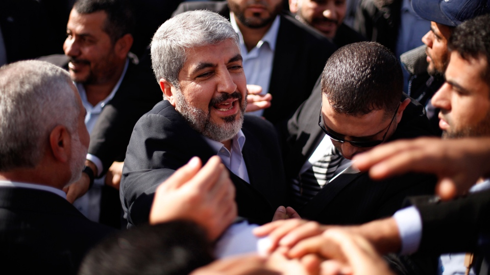 The exiled Hamas chief Khaled Mashaal shakes hands with supporters upon his arrival at Rafah crossing in the southern Gaza Strip, Friday, Dec. 7, 2012. (AP / Suhaib Salem)