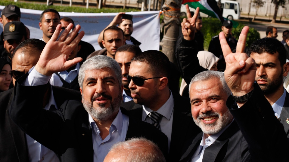Exiled Hamas chief Khaled Mashaal, left, and Gaza's Hamas Prime Minister Ismail Haniyeh upon Meshaal's arrival at Rafah crossing in the southern Gaza Strip, Friday, Dec. 7, 2012. (AP / Suhaib Salem, Pool)