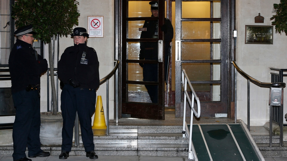 Police officers stand guard outside the King Edward VII hospital, in central London, Friday, Dec. 7, 2012. (AP / Lefteris Pitarakis)