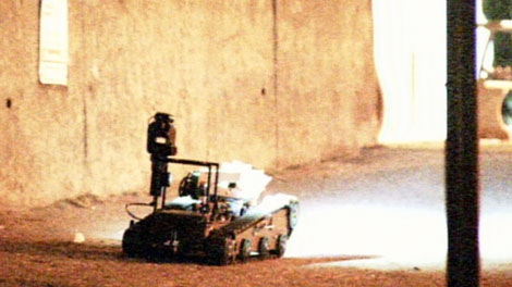A police robot enters the Ray-Cam Community Centre in Vancouver, where a three-year-old boy was held hostage. Nov. 23, 2010. (CTV)