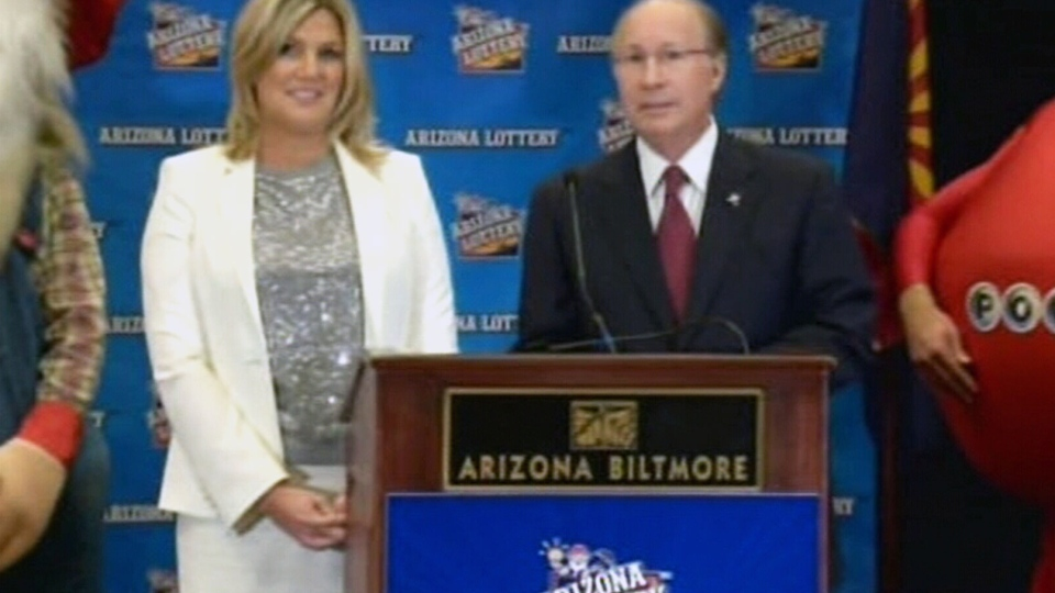 Officials with the Arizona Lottery announce the second winner of the Powerball jackpot lottery at a press conference in Phoenix, Ariz., Friday, Dec. 7, 2012.