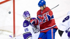 Montreal Canadiens' Scott Gomez, right, scores on Los Angeles Kings goaltender Jonathan Bernier during first period NHL hockey action in Montreal, Wednesday, November 24, 2010.THE CANADIAN PRESS/Graham Hughes