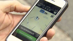 A customer uses his smart phone to contact Uber, a sedan taxi service. Dec. 7, 2012. (CTV)