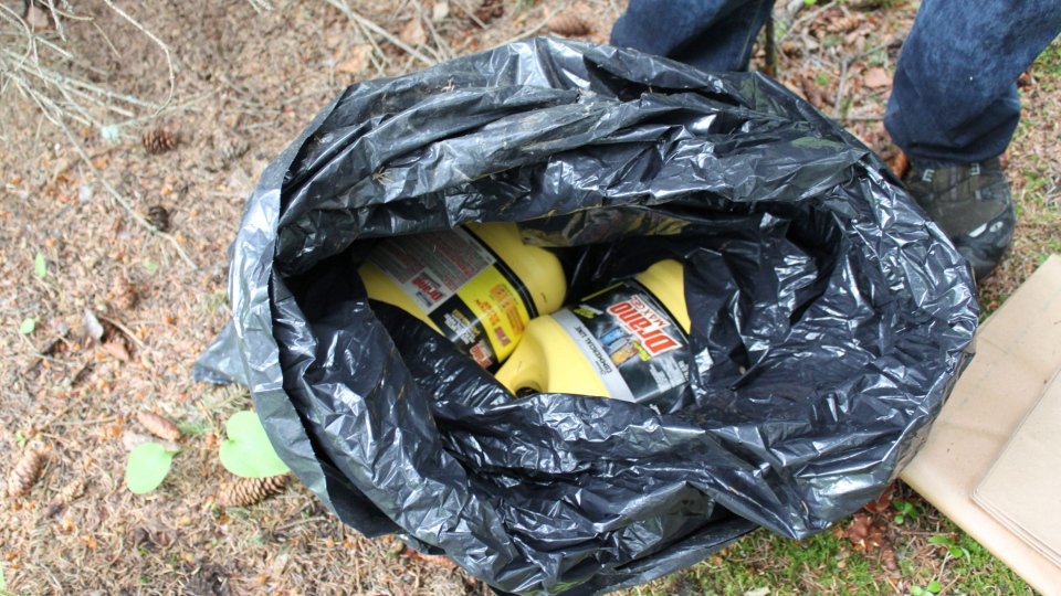 This undated photo provided by the FBI shows bottles of Drano found inside a plastic bag in Eagle River, Alaska, just north of Anchorage. (AP / FBI)
