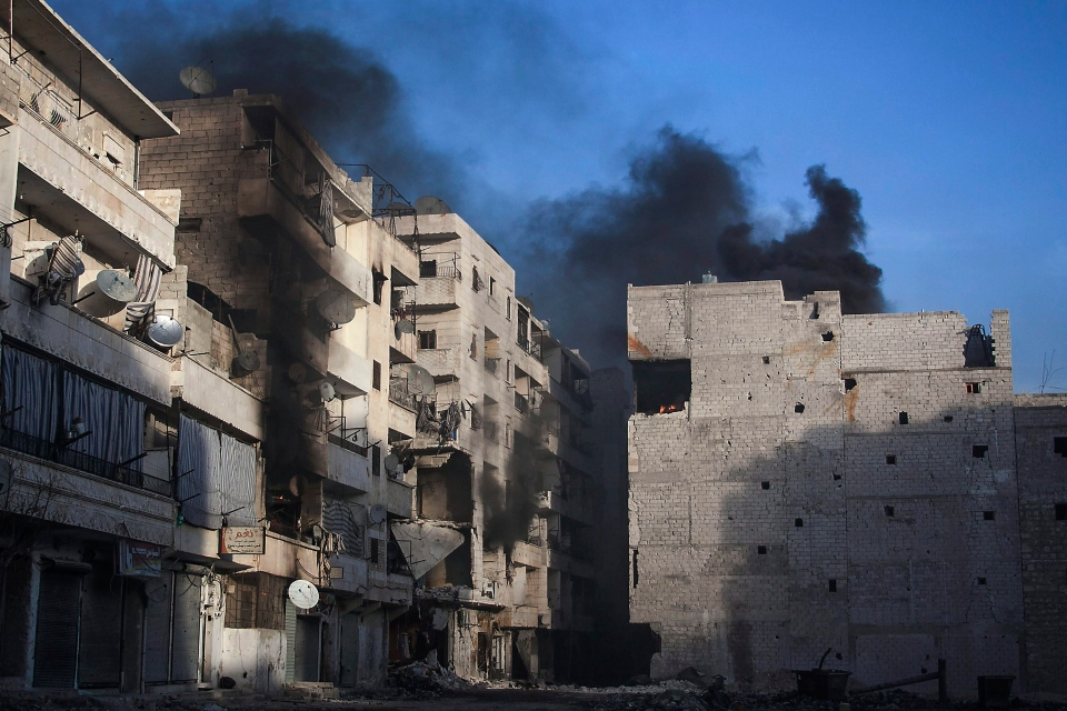 Smoke rises from residential buildings due heavy fighting between Free Syrian Army fighters and government forces in Aleppo, Syria on Wednesday, Dec. 5, 2012. (AP / Narciso Contreras)