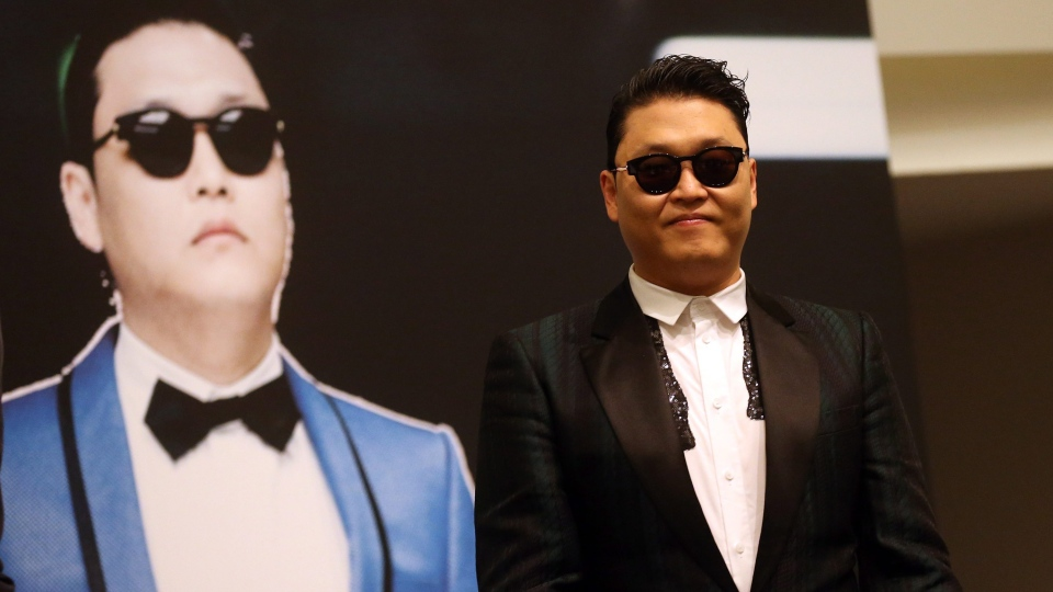 "South Korean rapper PSY, who gained popularity from his famous song ""Gangnam Style,"" gives a press conference prior to his concert at the Marina Bay Sands in Singapore on Saturday, Dec. 1, 2012. (AP / Wong Maye-E)"