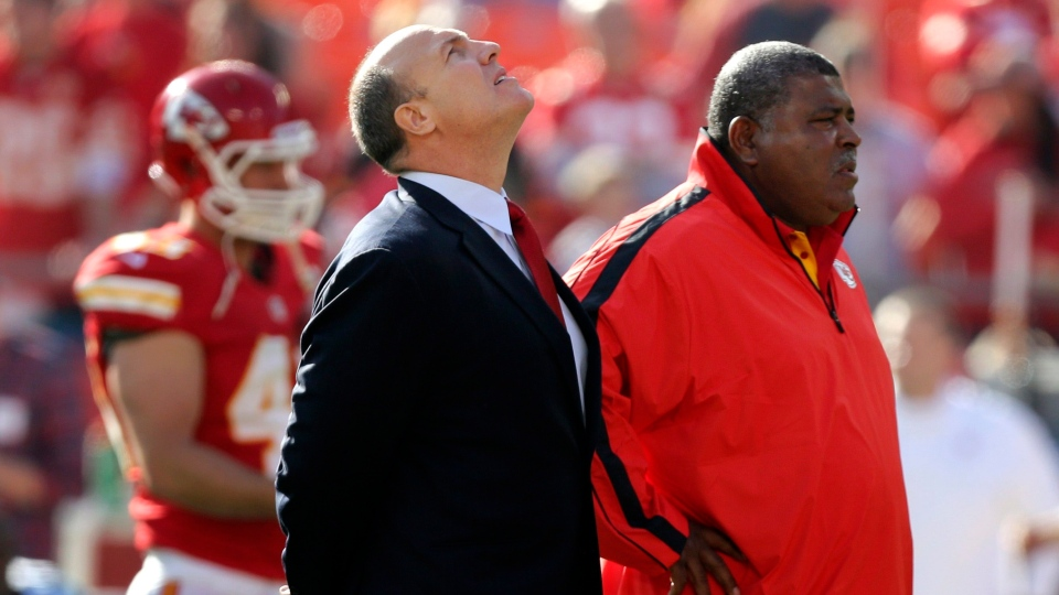 Kansas City Chiefs general manager Scott Pioli, left, and coach Romeo Crennel stand together before an NFL football game against the Carolina Panthers at Arrowhead Stadium in Kansas City, Mo., Sunday, Dec. 2, 2012. (AP / Ed Zurga)
