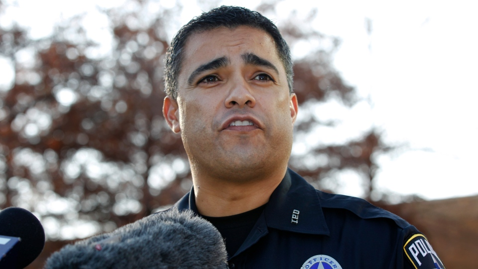 Irving Police Department Public Information Officer John Argumaniz responds to questions outside their department headquarters during a news conference regarding the auto accident involving Dallas Cowboys player Josh Brent, in Irving, Texas Saturday, Dec. 8, 2012. (AP / Tony Gutierrez)