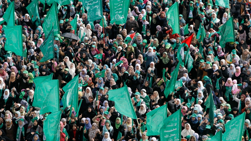Hamas supporters gather during a rally to commemorate the 25th anniversary of the Hamas militant group, in Gaza city, Saturday, Dec. 8, 2012. (AP / Hatem Moussa)