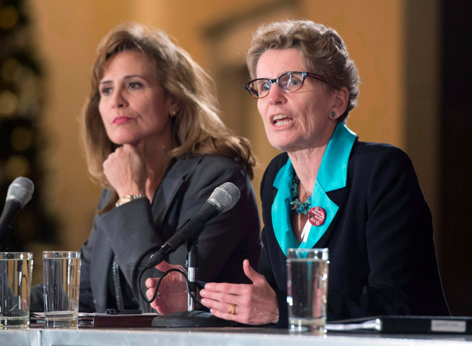 Ontario Liberal party leadership candidate Sandra Pupatello (left) listens as Kathleen Wynne speaks during a forum at Canadian Club of Toronto in Toronto on Thursday December 6, 2012. (Frank Gunn / THE CANADIAN PRESS)