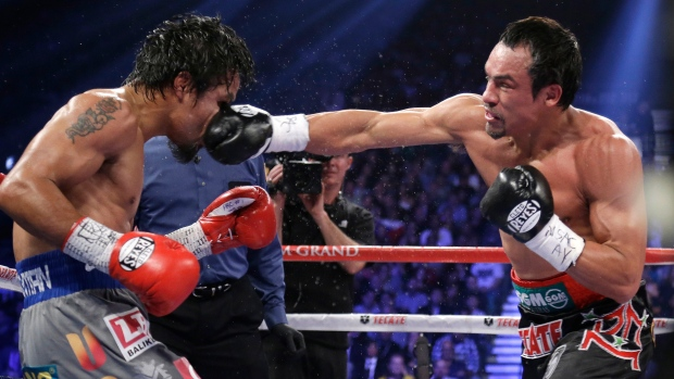 Juan Manuel Marquez punches Manny Pacquiao