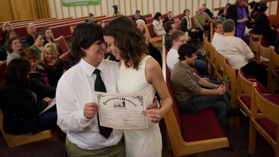 Jessica Lee, 19, left, and Ashley Cavner, 21, from Vancouver, WA, complete their wedding vows in Clark County shortly after midnight on Sunday, Dec. 9, 2012.  (AP / Steven Lane, The Columbian)