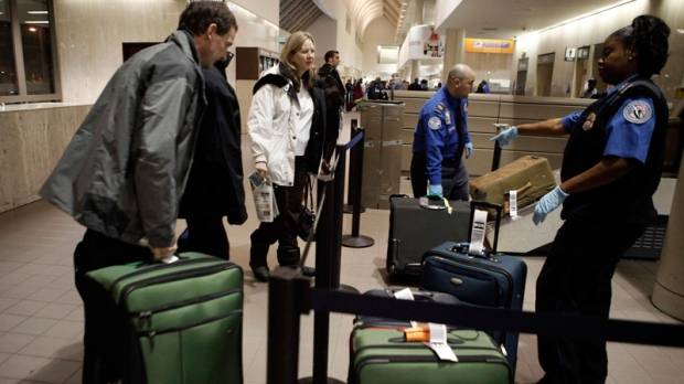Travelers drop off their luggage at the screening area at Los Angeles International Airport in Los Angeles, Wednesday, Nov. 24, 2010. (AP / Jae C. Hong)