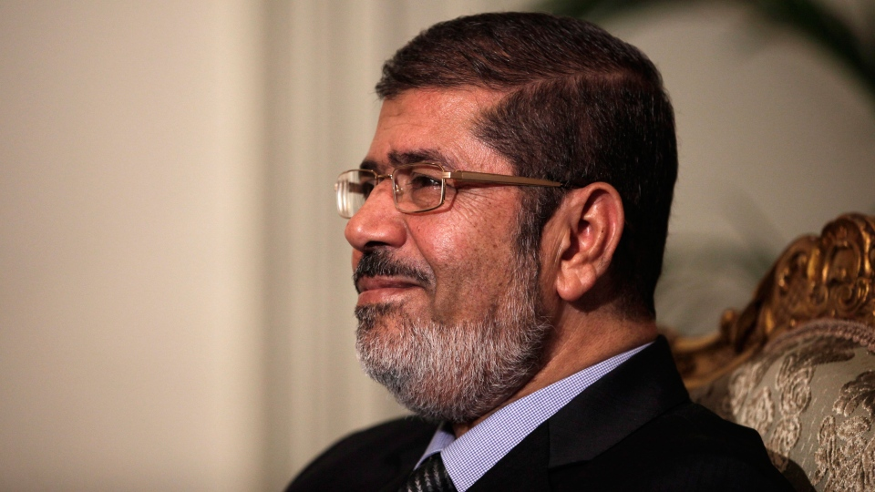 Egyptian President Mohammed Morsi poses during a photo opportunity at the presidential palace in Cairo, Egypt, Saturday, Dec. 8, 2012. (AP / Maya Alleruzzo)