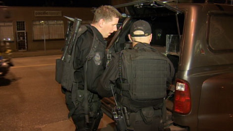 Vancouver police negotiate with a man with a knife who has barricaded himself and a young boy inside the Ray-Cam Community Centre. Nov. 23, 2010. (CTV)