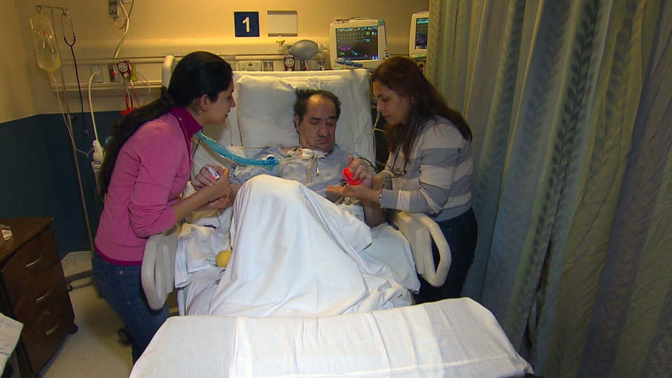 Hassan Rasouli, 60, is seen here with his wife and daughter by his bed side.