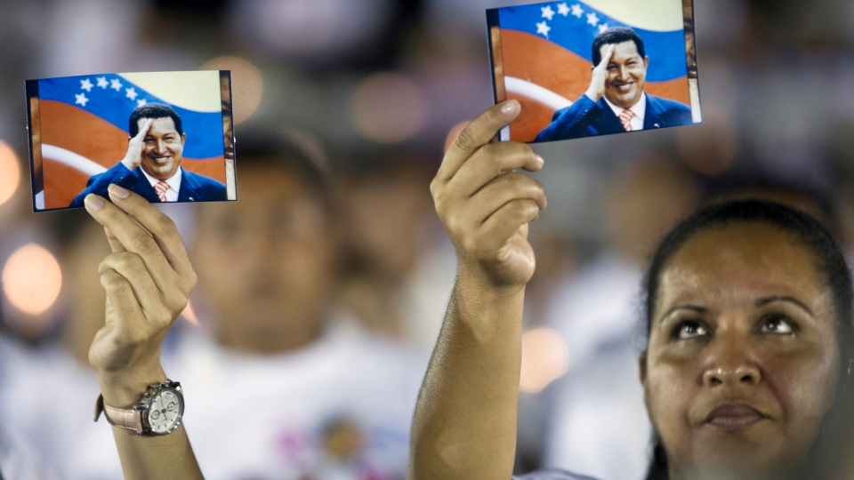 Supporters of the Venezuela's President Hugo Chavez hold his picture during a vigil in Managua, Nicaragua, Sunday Dec. 9, 2012. (AP / Esteban Felix)