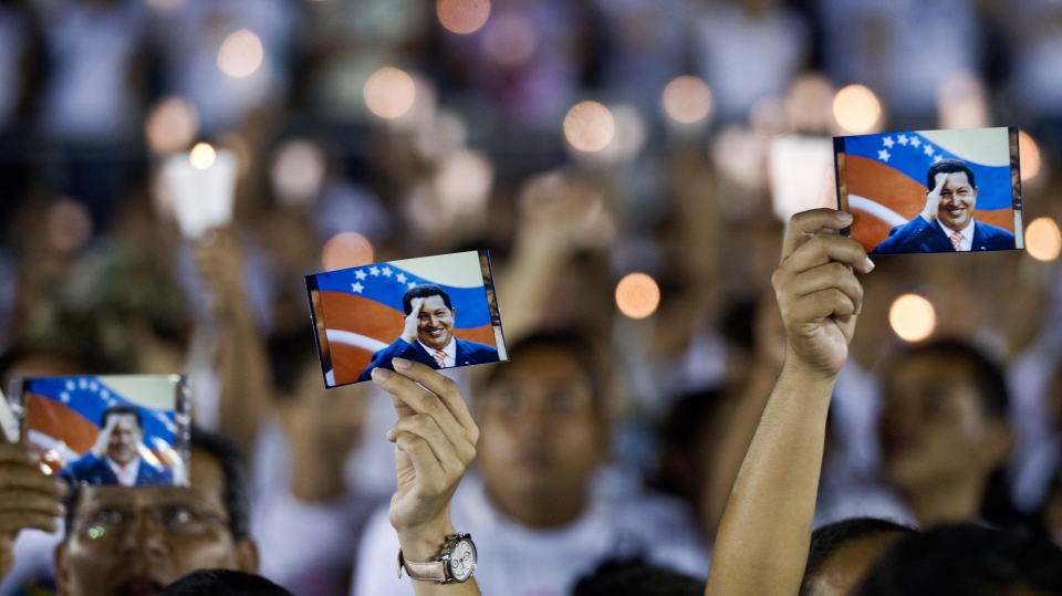 Supporters of Venezuela's President Hugo Chavez hold his picture during a vigil in Managua, Nicaragua, Sunday Dec. 9, 2012. (AP / Esteban Felix)