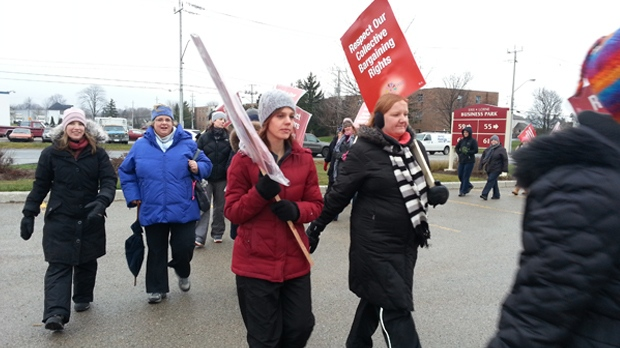 Elementary teachers protest outside school