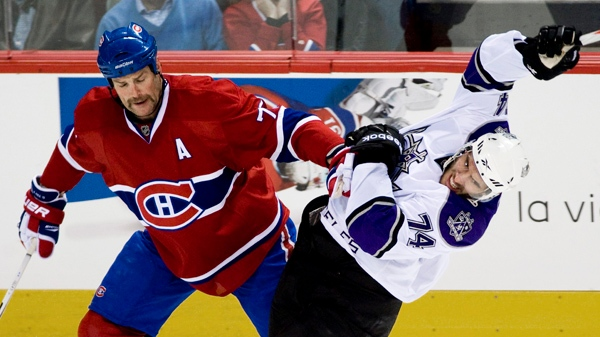 Montreal Canadiens' Hal Gill, left, checks Los Angeles Kings' Dwight King during second period NHL hockey action in Montreal, Wednesday, November 24, 2010.THE CANADIAN PRESS/Graham Hughes
