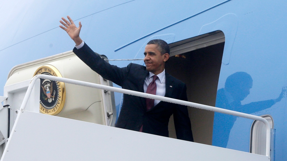 U.S. President Barack Obama turns and waves as he boards Air Force One at Andrews Air Force Base, Md., Monday, Dec. 10, 2012, as he travels to Michigan to visit the Daimler Detroit Diesel plant in Redford, Mich. (AP Photo/Charles Dharapak)