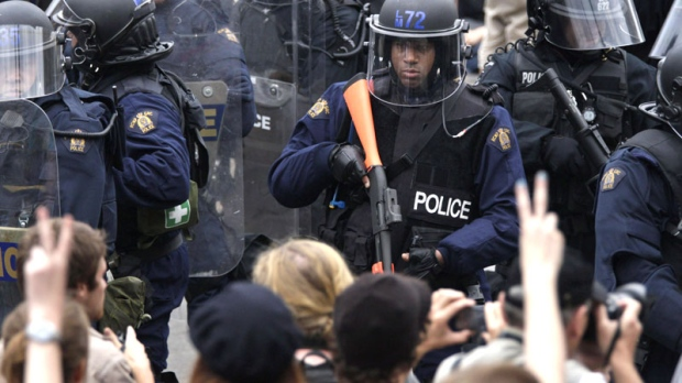 Riot police surround a large street demonstration on the closing day of the G20 Summit in Toronto, Sunday, June 27, 2010. (AP / Carolyn Kaster)
