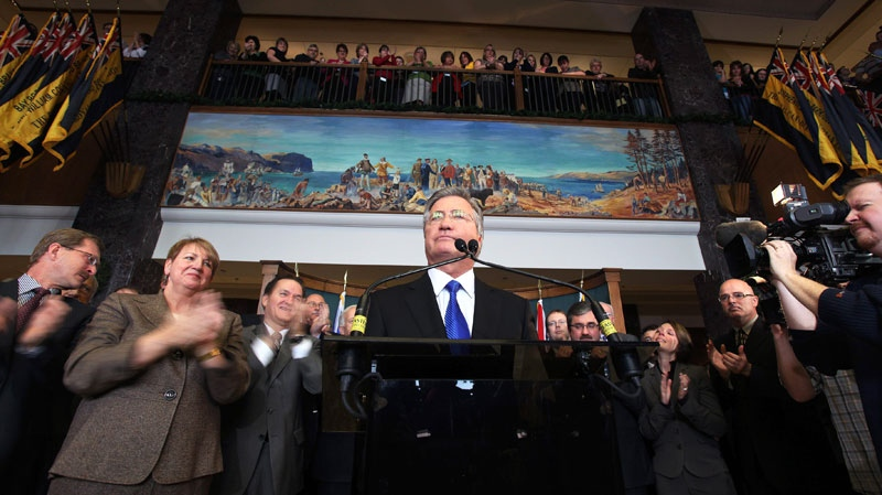 Standing in front of his cabinet and other party members, Newfoundland and Labrador Premier Danny Williams announces his resignation in the lobby of the Confederation Building in St. John's on Thursday, Nov. 25, 2010. (Paul Daly / THE CANADIAN PRESS)