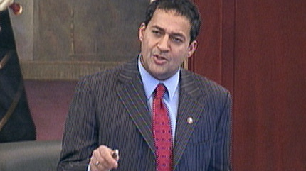 Dr. Raj Sherman proposes an amendment to legislation that would limit emergency room waiting times during an all-night session at the legislature.