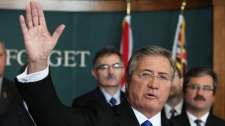 Newfoundland and Labrador Premier Danny Williams waves as he announces his resignation in the lobby of the Confederation Building in St. John's on Thursday, Nov. 25, 2010.  (Paul Daly / THE CANADIAN PRESS)