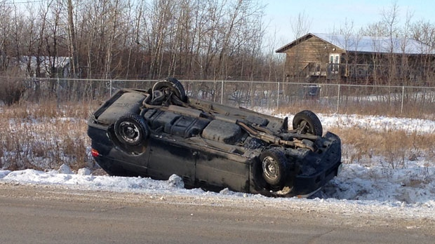 SUV in ditch near Fort Whyte Alive