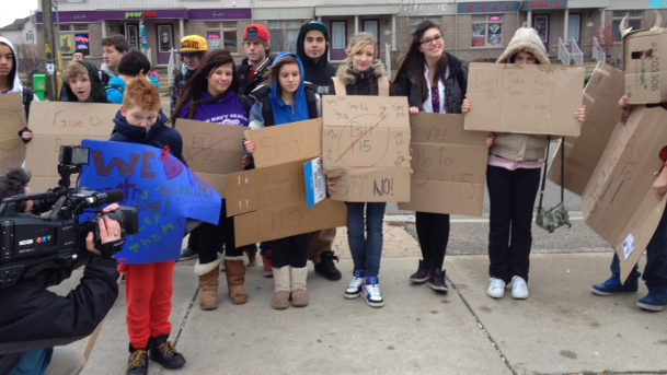 Students outside of Sir John A MacDonald in Waterloo hold signs against Bill 115. Dec.10, 2012
