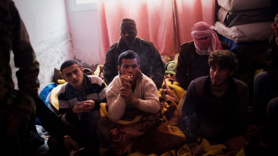 Syrian army solider defectors are seen in a temporary prison, as Free Syrian Army fighters investigate their identity, not pictured, in the village of Azaz, Syria, Monday, Dec. 10, 2012. (AP / Manu Brabo)