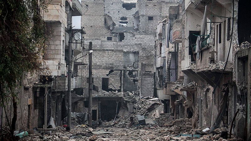 In this Friday, Dec. 07, 2012 photo, damaged buildings are seen along a desolate street on the front line after several weeks of intense battles between rebel fighters and troops loyal to Syrian President Bashar al-Assad in the Amarya district of Aleppo, Syria. (AP / Narciso Contreras)