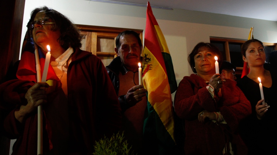 People participate in a vigil for Venezuela's President Hugo Chavez in La Paz, Bolivia, Monday Dec. 10, 2012. (AP / Juan Karita)