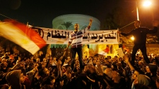 Protesters chant slogans demonstration Cairo Egypt
