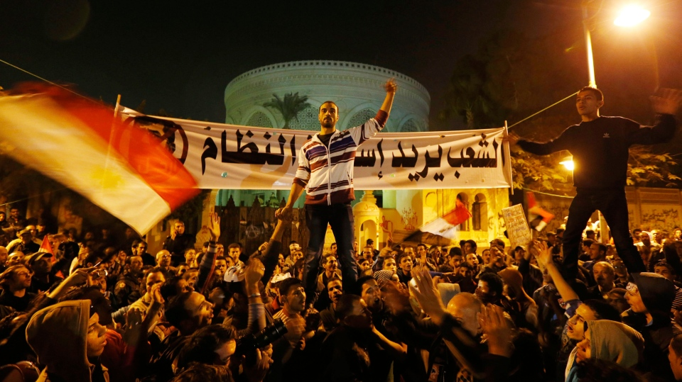 Protesters chant slogans during a demonstration in front of the presidential palace in Cairo, Egypt, Sunday, Dec. 9, 2012. (AP / Petr David Josek)