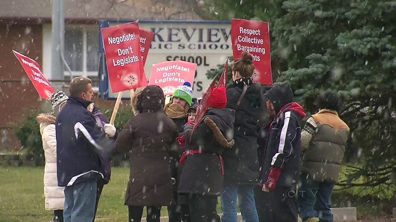 Teachers in Niagara and Keewatin-Patricia in northwestern Ontario stage a one-day strike, Tuesday, Dec. 11, 2012.