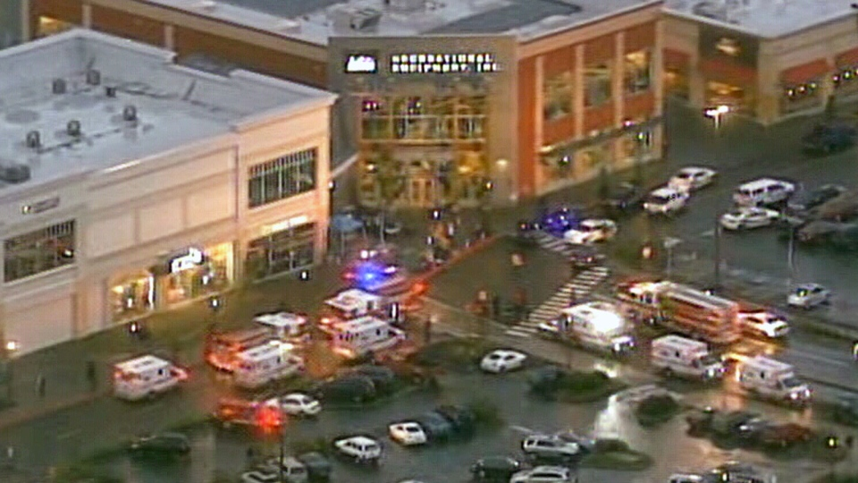 Emergency crews are shown outside the Clackamas Town Centre after gunfire was reported in Portland, Ore., Tuesday, Dec. 11, 2012.