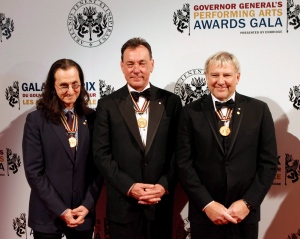 Members of the rock band Rush, Geddy Lee, Neil Peart and Alex Lifeson (left to right) pose before the start of the Governor General's Performing Arts Awards gala at the National Arts Center in Ottawa on Saturday, May 5, 2012. (The Canadian Press/Fred Chartrand)