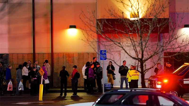 Shoppers wait to be evacuated outside the scene of a multiple shooting at Clackamas Town Center Mall in Clackamas, Ore., on Tuesday Dec. 11, 2012.  (AP / Greg Wahl-Stephens)