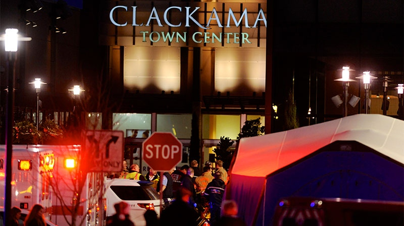 Police and medics work the scene of a multiple shooting at Clackamas Town Center Mall in Clackamas, Ore., Tuesday Dec. 11, 2012.  (AP / Greg Wahl-Stephens)