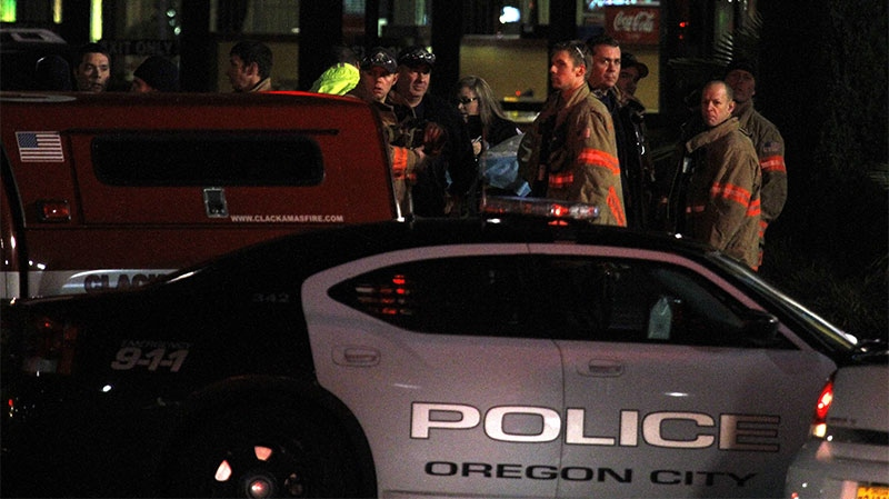 First responders stand outside where a gunman opened fire at the Clackamas Town Center shopping mall earlier in Portland, Ore., Tuesday, Dec. 11, 2012. (AP / Don Ryan)