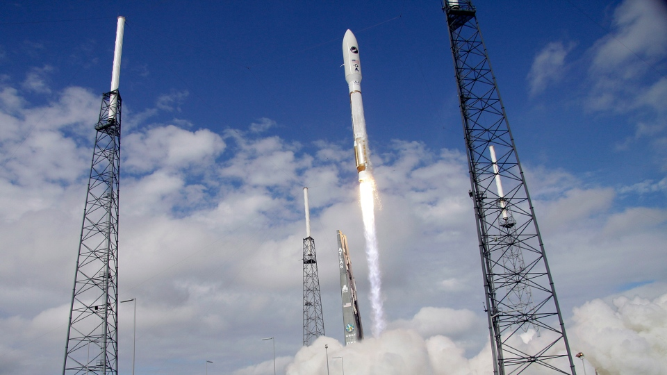A United Launch Alliance Atlas V rocket, carrying an X-37B experimental robotic space plane, lifts off from launch complex 41 at the Cape Canaveral Air Force Station in Cape Canaveral, Fla. Tuesday, Dec. 11, 2012. (AP / John Raoux)