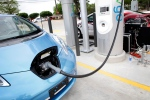 A Nissan Leaf is charged during a demo at the first ever quick charge vehicle charging station in the state of Texas in this 2011 file photo. (The Dallas Morning News)
