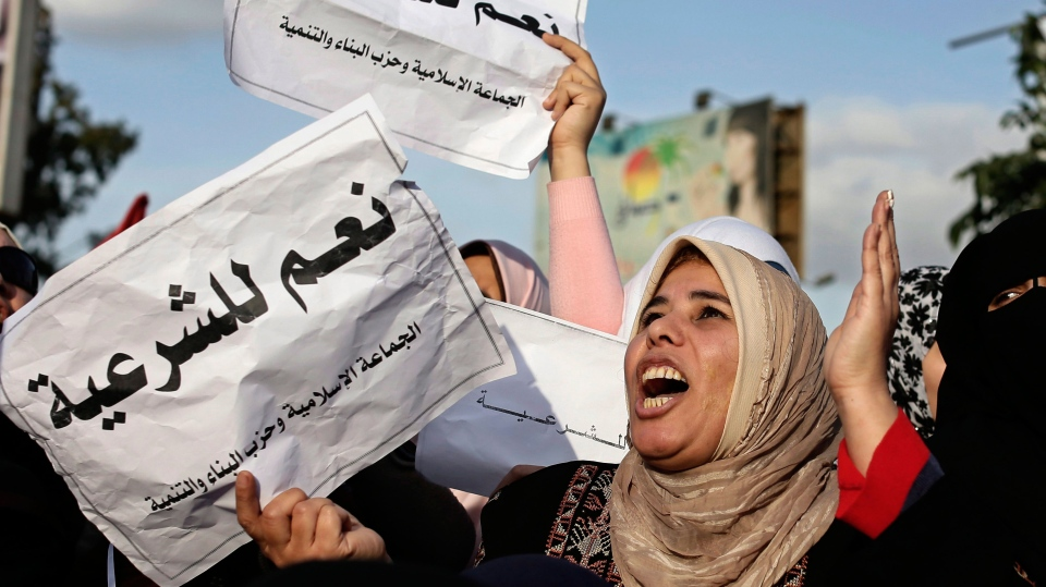 Supporters of Egyptian President Mohammed Morsi, chants slogans during a demonstration, in Cairo, Egypt, Tuesday, Dec. 11, 2012. (AP / Hassan Ammar)