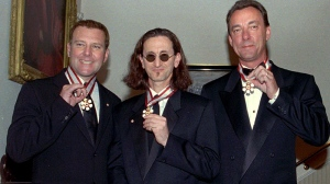 Members of the rock group 'Rush,' Alex Lifeson, Geddy Lee, and Neil Peart (left to right) display their Order of Canada medals which were presented to them at a ceremony at Rideau Hall in Ottawa on Wednesday, Feb. 2, 1997. (Jim Young / THE CANADIAN PRESS)