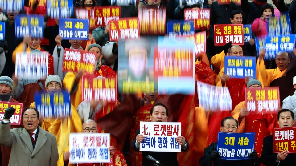 South Korean religious leaders raise placards and shout slogans during a rally denouncing North Korea's rocket launch in Seoul, South Korea, Wednesday, Dec. 12, 2012. (AP / Ahn Young-joon)